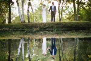 bride and groom flipped reflection on lake